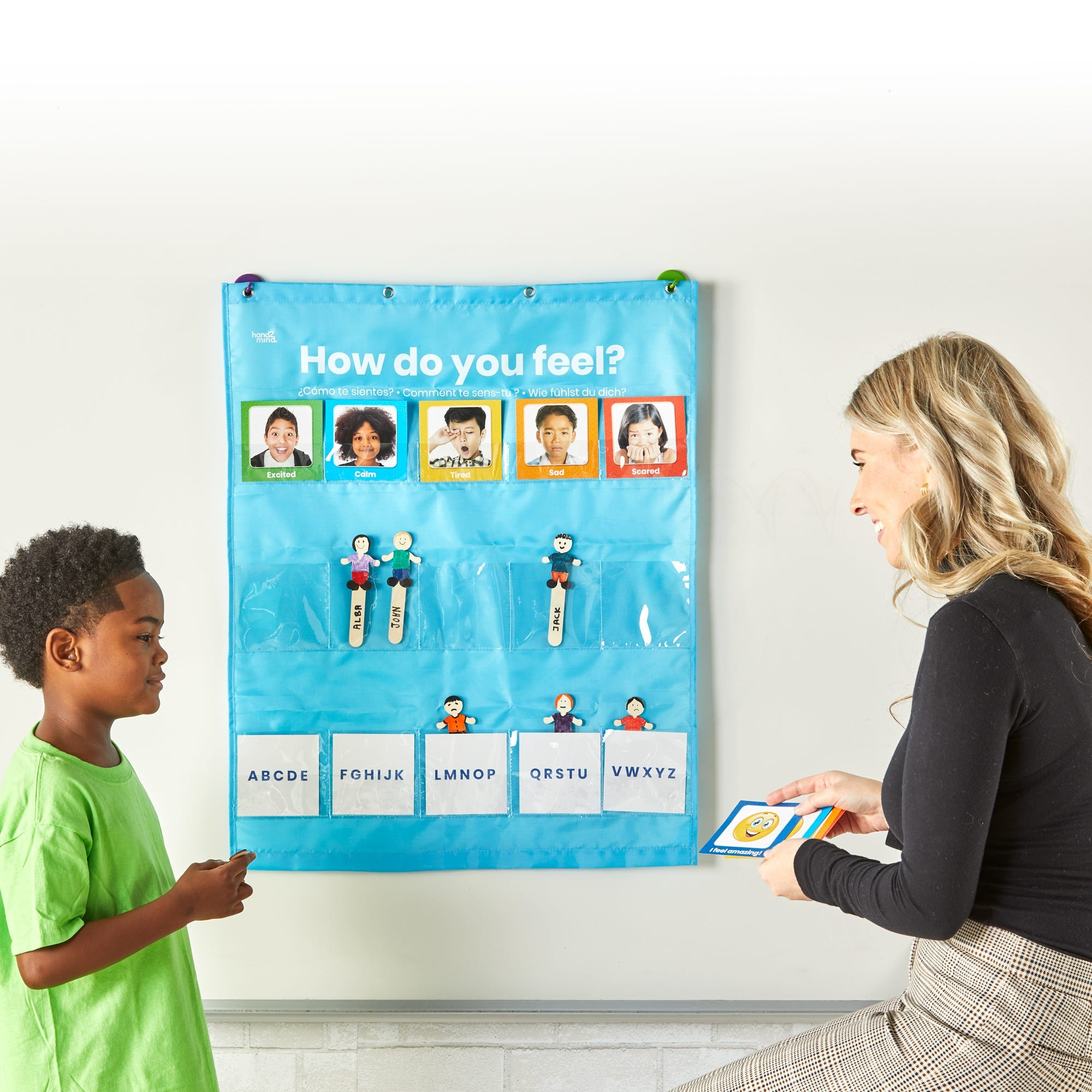 Grace and a little boy using the see my feelings pocket chart