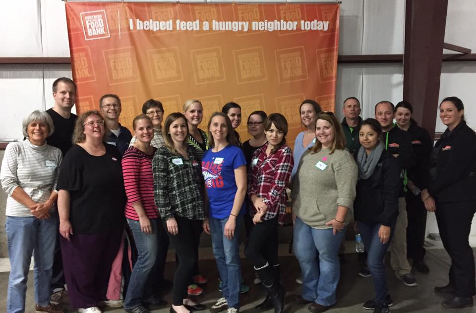 the hand2mind team volunteering at the greater northern Illinois food bank