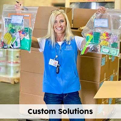 teacher holding up her custom student manipulative kits