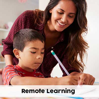 a mom helping her son during remote learning from home