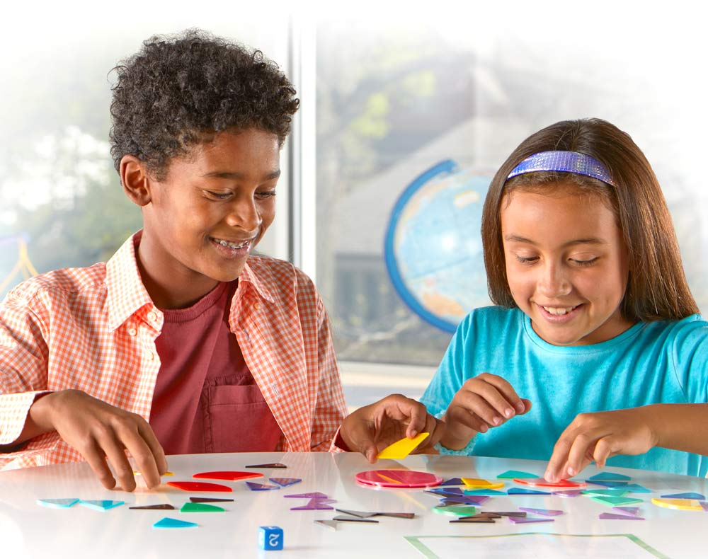 two kids playing with fraction circles during center math time