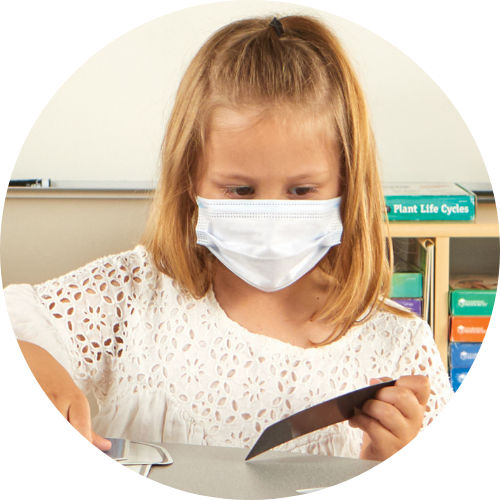 girl in a white shirt wearing a disposable face mask
