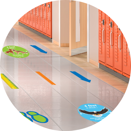social distance decals on the floor of a hallway in a school with orange lockers