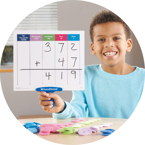 boy in a blue shirt holding up a paddle with place value on it