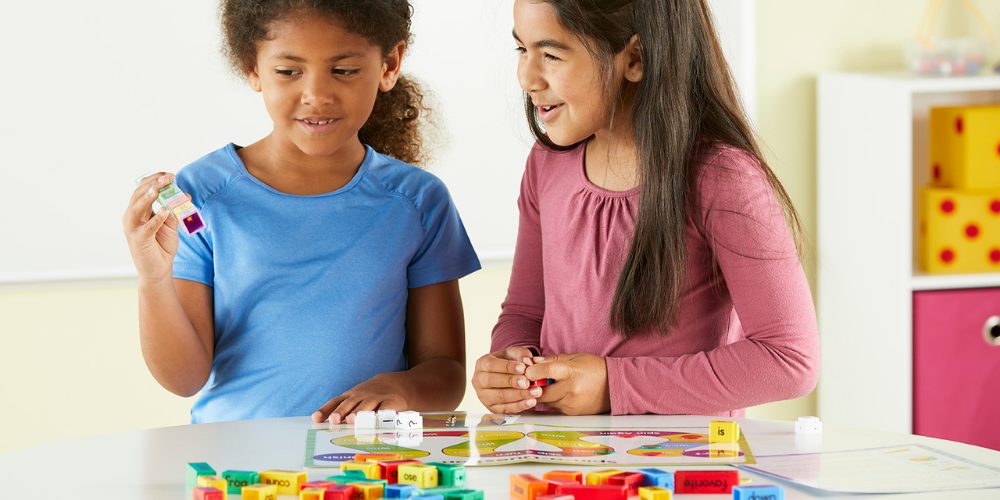 two girls using hands-on literacy products